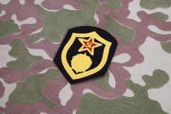 Soviet Army chemical troops shoulder patch on camouflage uniform. Background Stock Photography