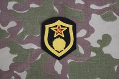 Soviet Army chemical troops shoulder patch on camouflage uniform. Background Royalty Free Stock Image