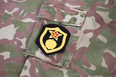 Soviet Army chemical troops shoulder patch on camouflage uniform. Background Royalty Free Stock Photo