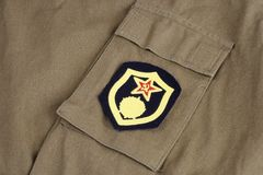 Soviet Army chemical troops shoulder patch on khaki uniform. Background Royalty Free Stock Images