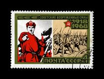 Soviet Red Army, marching military volunteers, 50th anniversary of the Armed Forces of the USSR, circa 1968,. MOSCOW, USSR - CIRCA 1968: canceled stamp printed Royalty Free Stock Photo