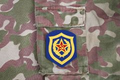 Soviet Army Mechanized infantry shoulder patch on camouflage uniform. Background Royalty Free Stock Images