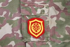 Soviet Army Mechanized infantry shoulder patch on camouflage uniform. Background Stock Photography