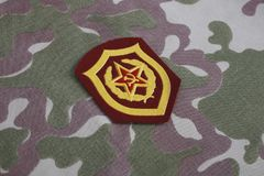 Soviet Army Mechanized infantry shoulder patch on camouflage uniform. Background Stock Images