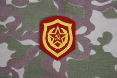 Soviet Army Mechanized infantry shoulder patch on camouflage uniform. Background Royalty Free Stock Photos