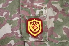 Soviet Army Mechanized infantry shoulder patch on camouflage uniform. Background Royalty Free Stock Image