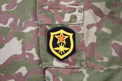 Soviet Army Signal Troops shoulder patch on camouflage uniform. Background Royalty Free Stock Photography