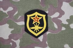 Soviet Army Signal Troops shoulder patch on camouflage uniform. Background Stock Image