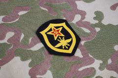 Soviet Army Signal Troops shoulder patch on camouflage uniform. Background Stock Photos