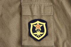 Soviet Army Signal Troops shoulder patch on khaki uniform. Background Royalty Free Stock Images
