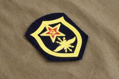 Soviet Army Signal Troops shoulder patch on khaki uniform. Background Royalty Free Stock Image