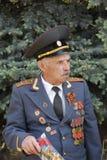Soviet Army veteran. SLAVIANSK, UKRAINE - MAY 9, 2012: MAY 9: Unidentified Soviet Army veteran of World War II on Victory day in Slaviansk on May 9, 2012 Stock Image