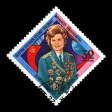 Valentina Tereshkova, Soviet astronaut, 1st woman in the space, red soviet flag, Madagascar , circa 1981, Stock Photography