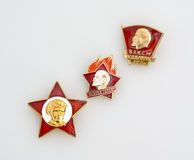 Soviet badges of  oktyabryonok, pioneer and komsomol Stock Images