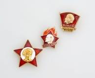 Soviet badges of  oktyabryonok, pioneer and komsomol Stock Images