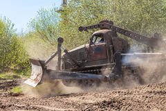Soviet BAT - M military bulldozer drives on track on a motortechnic festival Stock Photos