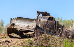 Soviet BAT - M military bulldozer drives on track on a motortechnic festival Stock Photos