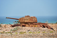 Soviet battle tank at the Socotra Island, Yemen. Rusty soviet battle tank T-34 on the shore of Indian ocean at the Socotra Island, Yemen Royalty Free Stock Image