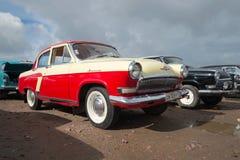 Soviet car Volga GAZ-21, under a cloudy sky. Exhibition of vintage cars in Kronstadt Royalty Free Stock Photo