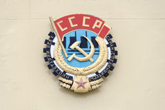 Soviet CCCP emblem with hammer and sickle. On a wall stock images