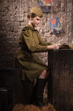 Soviet Female Soldier In Uniform Of WW II Reads The Letter Stock Photography