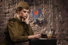 Soviet female soldier in uniform of World War II writes a letter Royalty Free Stock Photos