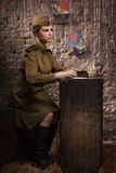 Soviet female soldier in uniform of World War II writes a letter Stock Images