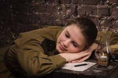 Soviet female soldier in uniform of WWII sleeping in the dugout Royalty Free Stock Images
