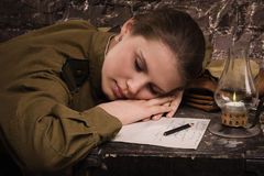 Soviet female soldier in uniform of WWII sleeping in the dugout Stock Photography