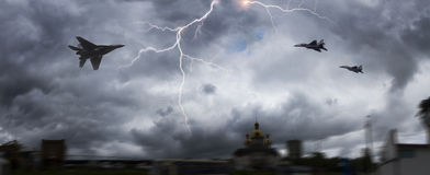 Soviet fighter and thunderstorm. Soviet army fighter in dangerous proximity to thunderstorms in cumulus clouds. Perfect technique is a symbol of military Stock Images