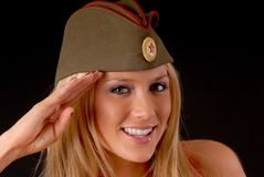 Soviet Girl. Isolated lovely and young blond girl wearing a soviet army cap stock photos