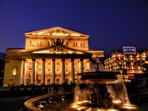 The Soviet Glory is not all gone yet.. The Bolshoi Theatre and the posh Tsum Mall shine bright under a darkening evening sky Royalty Free Stock Photo