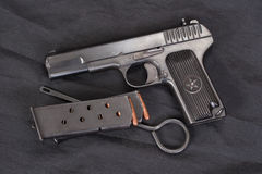 Soviet handgun on black Stock Photos