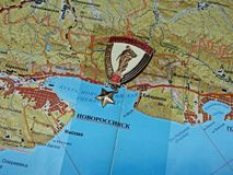 Soviet icon with the inscription `hero city of Novorossiysk` on the tourist map. Map text in Russian. Travel planning map. royalty free illustration