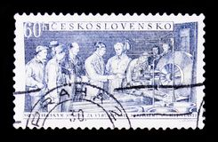 Soviet industrial instruction, building socialism in our country with soviet union, circa 1965. MOSCOW, RUSSIA - JUNE 20, 2017: A stamp printed in Czechoslovakia stock images