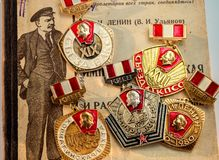 Soviet jubilee medals depicting Lenin against the background of the second-hand books of Lenin printed in 1925 stock photo