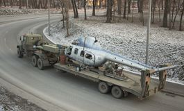 A Soviet-made military truck is transported by a broken helicopter. Top view Stock Photo