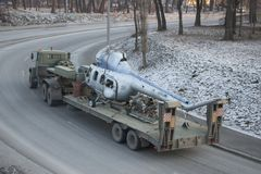 A Soviet-made military truck is transported by a broken helicopter royalty free stock images