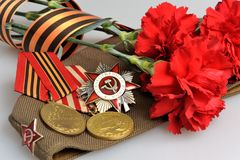 Soviet military cap, flowers, Saint George ribbon, medals of Gre Stock Photo