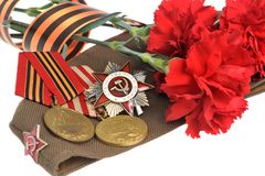 Soviet military cap with red flowers, Saint George ribbon, medals of Great Patriotic war Stock Photos