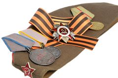 Soviet military cap, Saint George ribbon, medals of Great Patriotic war Royalty Free Stock Photos