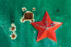 Soviet military five-pointed star on the green scuffed gate Royalty Free Stock Image