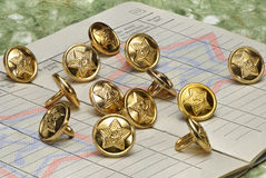 Soviet military metal buttons on a military document. Stock Photography