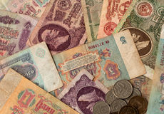 Soviet money. Soviet rubles and coins on the background of large Royalty Free Stock Photography