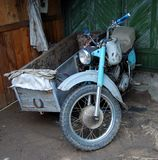 Soviet motorcycle. Abandoned old fashioned soviet motorcycle, front view Stock Photos
