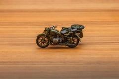Soviet motorcycle with sidecar. Handmade miniature plastic model Royalty Free Stock Photo