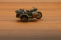 Soviet motorcycle with sidecar. Handmade miniature plastic model Stock Images