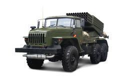 Soviet Multiple Rocket Launcher BM-21 Grad 122 mm mounted on chassis of truck Ural-375D. Isolated on white background stock photo