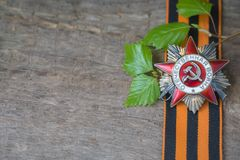 The Soviet order of the Second World war and George ribbon Victory Day 9 May postcard concept. Toned vintage Royalty Free Stock Photography
