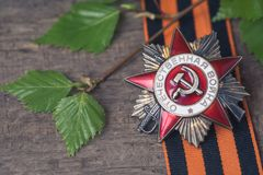 The Soviet order of the Second World war and George ribbon Victory Day 9 May postcard concept. Toned vintage Stock Image